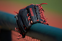 A Wilson A2000 model glove sits on the Georgia Bulldogs dugout railing prior to the game against the LSU Tigers at Foley Field on March 23, 2019 in Athens, Georgia. The Bulldogs defeated the Tigers 2-0. (Brian Westerholt/Four Seam Images)