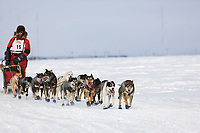 Musher Lance Mackey heads outside of Nome during the 2008 All Alaska Sweepstakes 100 year commemorative sled dog race.