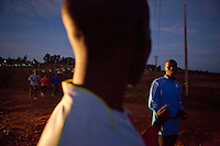 Wilson Kipsang, right, who ran the 2011 Frankfurt marathon in 2:03:42,  just 4 seconds off the world record, trains with a group of athletes from 6 am each day in Iten Kenya. Iten, famous for it's world champion runners and its high-altitude trianing, is fast becoming a destination for international athletes who want to train  with the best of the best.