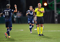 LAKE BUENA VISTA, FL - AUGUST 01: Referee Robert Sibiga speaks to Valentín Castellanos #11 of New York City FC during a game between Portland Timbers and New York City FC at ESPN Wide World of Sports on August 01, 2020 in Lake Buena Vista, Florida.