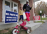 GREENSBORO, NC - NOVEMBER 4:   Linda Massey-Roberts walks with her grandson Brayen Massey, 2, after Massey-Roberts voted at Trinity A.M.E. Zion Church in Greensboro, NC, on Tuesday, November 4, 2014.  Brayen arrived at the polls on his red tricycle.  (Photo by Ted Richardson/For The Washington Post)
