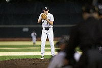 Wake Forest Demon Deacons starting pitcher Ryan Cusick (33) looks to his catcher for the sign against the Louisville Cardinals at David F. Couch Ballpark on March 6, 2020 in  Winston-Salem, North Carolina. The Cardinals defeated the Demon Deacons 4-1. (Brian Westerholt/Four Seam Images)