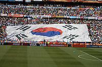 South Korea fans wave a large national flag at Soccer City in Johannesburg, South Africa on Thursday, June 17, 2010 during Argentina's and South Korea FIFA World Cup first round match.