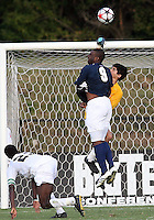 04 September 2009:Bright Dike #9 of the University of Notre Dame crashes into Akira Fitzgerald #1 of Wake Forest University during an Adidas Soccer Classic match at the University of Indiana in Bloomington, In. The game ended in a 1-1 tie..