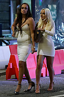 Pictured: Two young women walk in Wind Street, Swansea, Wales, UK. Saturday 07 August 2021<br /> Re: Nightclubs have reopened this weekend as most Covid restrictions have come to an end in Wales, UK.<br /> Pubs and restaurants were allowed to open for certain periods, with safety measures in place unlike nightclubs.
