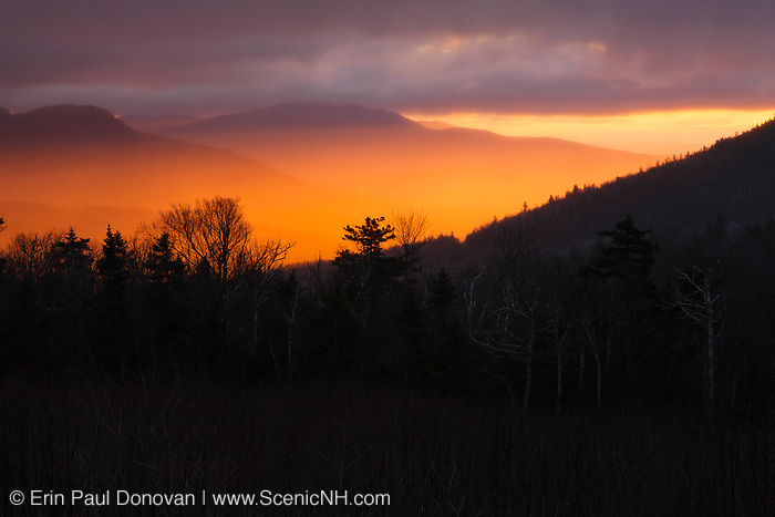 Sunrise and storm clouds along the Kancamagus Highway (route 112), which is one of New England's scenic byways located in the White Mountains, New Hampshire USA.