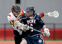 Dean Hart (16) of Maryland tries to stop the progress of Chris Harms (6) of Penn at Ludwig Field in College Park, Maryland.
