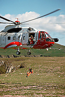 H.M. Coastguard Sikorsky S.61N Helicopter winchman being lowered down to rescue person trapped on a cliff. This image may only be used to portray the subject in a positive manner..©shoutpictures.com..john@shoutpictures.com