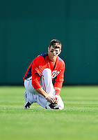 2 March 2011: Washington Nationals outfielder Bryce Harper ties a shoe during Spring Training action against the Florida Marlins at Space Coast Stadium in Viera, Florida. The Nationals defeated the Marlins 8-4 in Grapefruit League action. Mandatory Credit: Ed Wolfstein Photo