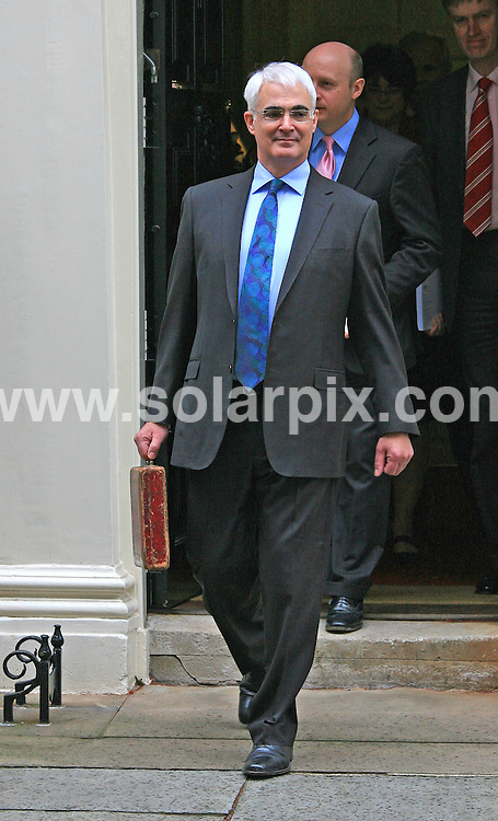 **ALL ROUND PICTURES FROM SOLARPIX.COM**.**WORLDWIDE SYNDICATION RIGHTS**.Chancellor of the Exchequer Alistair Darling poses with a briefcase containing the Budget Report outside Downing Street in London on Wednesday 24 March 2010. The Labour government will deliver a critical pre-election budget to help fix the dire public finances but some experts fear political posturing with an election around the corner..This pic:   Chancellor of the Exchequer Alistair Darling.JOB REF:   10970    LDN     DATE:  24.03.10.**MUST CREDIT SOLARPIX.COM OR DOUBLE FEE WILL BE CHARGED**.**MUST NOTIFY SOLARPIX OF ONLINE USAGE**.**CALL US ON: +34 952 811 768 or LOW RATE FROM UK 0844 617 7637**