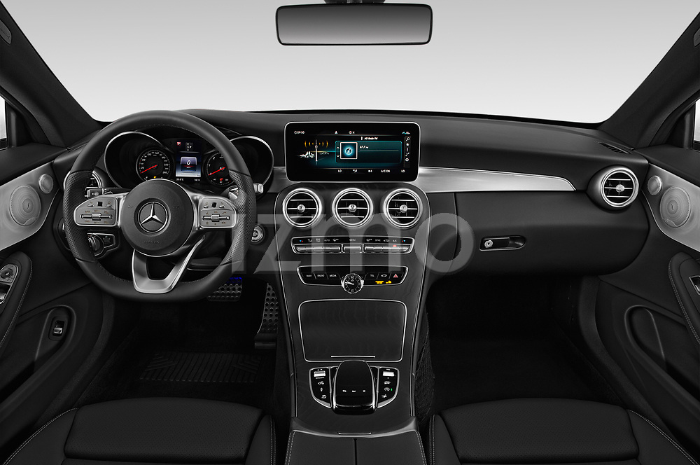 Stock photo of straight dashboard view of 2019 Mercedes Benz C-Class AMG-Line 2 Door Coupe Dashboard