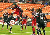WASHINGTON, D.C - March 29 2014: Jhon Kennedy Hurtado of Chicago heads in the first goal, D.C. United vs the Chicago Fire in an MLS match at RFK Stadium, in Washington D.C. The game ended in a 2-2 tie.