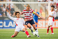 Han Peng (18) of China PR (CHN) challenges Christie Rampone (3) of the United States (USA) for the ball. The United States (USA) women defeated China PR (CHN) 4-1 during an international friendly at PPL Park in Chester, PA, on May 27, 2012.