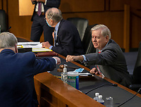 United States Senator Lindsey Graham (Republican of South  Carolina), Chairman, US Senate Judiciary Committee, right, gives a fist bump to a visitor before the Senate Judiciary committee continues its hearing on the confirmation of Judge Amy Coney Barrett to the Supreme Court, in Washington, DC on October 15, 2020.<br /> Credit: Bill O'Leary / Pool via CNP /MediaPunch