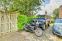 BNPS.co.uk (01202 558833)<br /> Pic: PropertyPublicity/BNPS<br /> <br /> Pictured: There's room for parking<br /> <br /> Loco-cation, loco-cation, loco-cation..<br /> <br /> This quirky property that is up for sale is all about its loco-cation - as it sits on a railway crossing right next to the train tracks.<br /> <br /> The Grade II listed cottage was built in 1850 to house the gatekeeper whose job it was to close the gates at the road crossing whenever a train was due.<br /> <br /> The gates, in the village of Stone, Staffs, were automated many years ago.