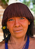 Pará State, Brazil. Aldeia Ipixuna (Araweté). Araweté woman with green eyes and urucum in her hair.