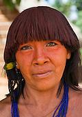 Pará State, Brazil. Aldeia Ipixuna (Araweté). Araweté woman with green eyes and urucum in her hair.