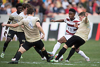 Houston, TX -  Sunday, December 11, 2016: Bryce Marion (7) of the Stanford Cardinal battles for the ball with Kevin Politz (4) and Brad Dunwell (12) of the Wake Forest Demon Deacons at the  NCAA Men's Soccer Finals at BBVA Compass Stadium.