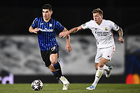 16th March 2021; Madrid, Spain; during the Champions League match, round of 16, between Real Madrid and Atalanta;  Ruslan Malinovskyi chased by Toni Kro