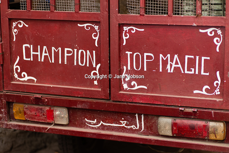 Hand-painted sign on the back of a truck in the Kasbah, Marrakech, Morocco.