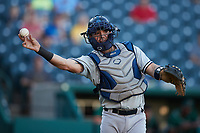 Hudson Valley Renegades catcher Austin Wells (10) makes a throw to first base against the Greensboro Grasshoppers at First National Bank Field on September 2, 2021 in Greensboro, North Carolina. (Brian Westerholt/Four Seam Images)