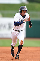 NW Arkansas Naturals designated hitter Mark Threlkeld (26) runs the bases during a game against the Corpus Christi Hooks on May 26, 2014 at Arvest Ballpark in Springdale, Arkansas.  NW Arkansas defeated Corpus Christi 5-3.  (Mike Janes/Four Seam Images)
