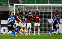 Football Soccer: Tim Cup Quarter Finals InternazionaleMIlan vs Milan, Giuseppe Meazza Stadium (San Siro) Milan, on January 26, 2021.<br /> Inter's Christian Eriksen (l) scores during the Italian Tim Cup football match between Inter  and Milan at the Giuseppe Meazza stadium in Milan, January 26, 2021.<br /> UPDATE IMAGES PRESS/Isabella Bonotto