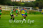 Javier Cayoni Killorglin goes past Cillian Horan and Jack Power Camp during their game in Killorglin on Friday