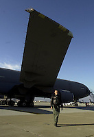 An Air Force crew member from from the 60th Air Refueling Squadron at Travis Air Force base inspects a KC-10 air tanker at the base in Fairfield, Calif., Friday Oct. 5 2001. The KC-10 tankers can transfer up to 340,000 pounds of fuel on a mission. (CONTRA COSTA TIMES/ ALAN GRETH)