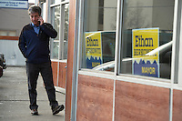 Anchorage Mayoral Candidate Ethan Berkowitz takes a call before a fundraiser at his campaign headquarters in midtown Anchorage. Berkowitz won the election following a runoff against Amy Demboski.