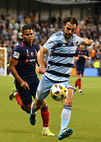KANSAS CITY, KS - SEPTEMBER 11: Graham Zusi #8 of Sporting Kansas City fires off a shot from outside the box during a game between Chicago Fire FC and Sporting Kansas City at Children's Mercy Park on September 11, 2021 in Kansas City, Kansas.