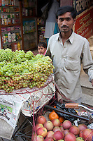 Kathmandu, Nepal.  Grape and Apple Vendor, Downtown Kathmandu.