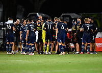 LAKE BUENA VISTA, FL - JULY 26: Sporting KC take in fluids during a game between Vancouver Whitecaps and Sporting Kansas City at ESPN Wide World of Sports on July 26, 2020 in Lake Buena Vista, Florida.