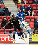 St Johnstone v Motherwell…08.08.21  McDiarmid Park<br />Shaun Rooney gets above Jake Carroll<br />Picture by Graeme Hart.<br />Copyright Perthshire Picture Agency<br />Tel: 01738 623350  Mobile: 07990 594431