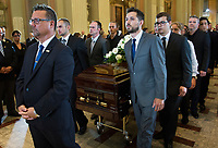 Family members of of Paul Gerin-Lajoie remove is coffin from Mary Queen of the World Cathedral following his funeral in Montreal, Thursday, August 9, 2018.THE CANADIAN PRESS/Graham Hughes