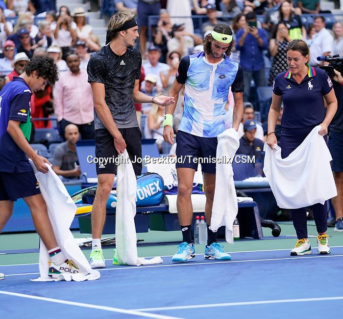 September  8, 2021:  Alexander Zverev (GER) and Lloyd Harris (RSA) help mop the court at the US Open being played at Billy Jean King National Tennis Center in Flushing, Queens, New York / USA  ©Jo Becktold/Tennisclix/CSM/CSM