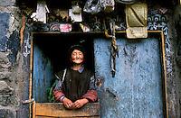 Lunang Valley, Tibet 2006. Woman in doorway, Lunang Valley, Central Tibet, 2006