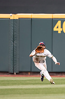 Michigan Wolverines outfielder Jesse Franklin (7) attempts a diving catch during Game 1 of the NCAA College World Series against the Texas Tech Red Raiders on June 15, 2019 at TD Ameritrade Park in Omaha, Nebraska. Michigan defeated Texas Tech 5-3. (Andrew Woolley/Four Seam Images)