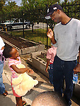 Actor/Comedian Chris Rock talks with Hurricane Katrina evacuee Jarlai Morris while on a visit to the Bonita House in Houston,Texas Thursday Sept. 29,2005.