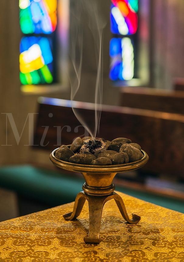 Incense burns in monastic chapel.