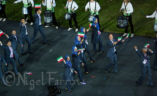 27 JUL 2012 - LONDON, GBR - The team from Iran (IRI) walk around the Olympic Stadium during the Opening Ceremony of the London 2012 Olympic Games in Stratford, London, Great Britain .(PHOTO (C) 2012 NIGEL FARROW)