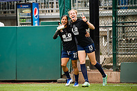 TACOMA, WA - JULY 31: Celia Jimenez Delgado #13 and Shirley Cruz #28 of the OL Reign before a game between Racing Louisville FC and OL Reign at Cheney Stadium on July 31, 2021 in Tacoma, Washington.