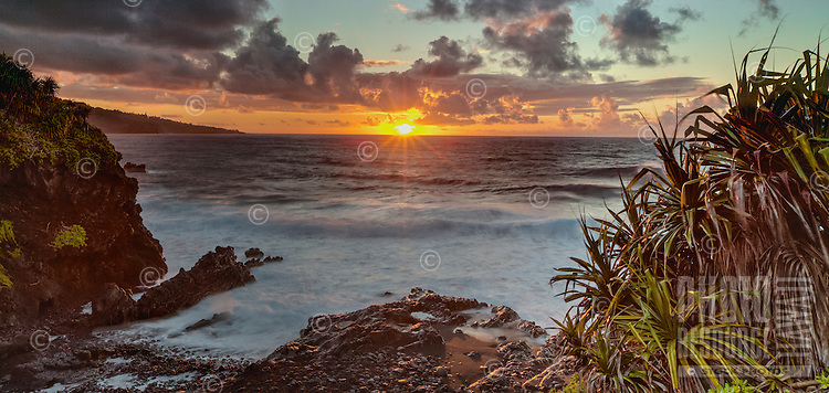 The sunset ocean view from 'Ohe'o Gulch Falls (or Seven Sacred Pools), Haleakala National Park, southeastern Maui.