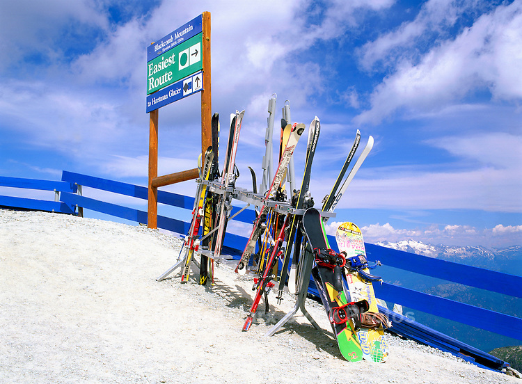 Downhill Skis and Snowboards leaning against Ski Racks at Horstman Glacier on Blackcomb Mountain, Whistler Ski Resort, BC, British Columbia, Canada