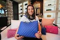 April 20, 2017. Carlsbad, CA. USA.|Christina Samoylov owner of Designer Vault in Carlsbad holds a  Chanel purse. |Photos by Jamie Scott Lytle. Copyright.