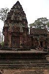 Angkorian temple Banteay Srei (late 10th century) 967.<br /> South side of the south sanctuary tower.<br /> Three sanctuary towers.The central sanctuary and the southern sanctuary were dedicated to Shiva and the northern sanctuary was dedicated to Vishnu.<br /> Banteay Srei temple is situated 20km north of Angkor, built during the reign of Rajendravarman by Yajnavaraha, one of his counsellors. In antiquity Isvarapura was a small city that grew up around the temple. Banteay Srei was dedicated to the worship of Shiva, the foundation stele describes the consecration of the linga Tribhuvanamahesvara (Lord of the three worlds) in 967.