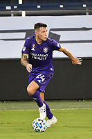 KANSAS CITY, KS - SEPTEMBER 23: Kyle Smith #24 of Orlando City on the ball during a game between Orlando City SC and Sporting Kansas City at Children's Mercy Park on September 23, 2020 in Kansas City, Kansas.