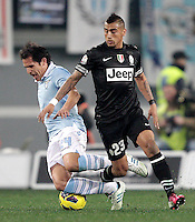 Calcio, semifinale di ritorno di Coppa Italia: Lazio vs Juventus. Roma, stadio Olimpico, 29 gennaio 2013..Lazio midfielder Cristian Ledesma is challenged by Juventus midfielder Arturo Vidal, of Chile, right, during the Italy Cup football semifinal return leg match between Lazio and Juventus at Rome's Olympic stadium, 29 January 2013..UPDATE IMAGES PRESS/Riccardo De Luca