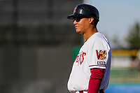 Wisconsin Timber Rattlers infielder Fidel Pena (12) coaches first base during a Midwest League game against the Quad Cities River Bandits on April 8, 2017 at Fox Cities Stadium in Appleton, Wisconsin.  Wisconsin defeated Quad Cities 3-2. (Brad Krause/Four Seam Images)