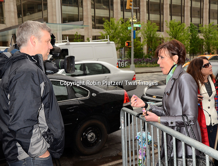 """Colleen Zenk  being interviewed by Canadian TV at the protest of  the cancelation of ABC's """"All My Children"""" and """"One Life to Live"""" outside Lincoln Center where ABC was presenting it's Upfront of the 2011-2012 Fall Season  on May 17, 2011 in New York City. The protesters were trying to get the advertisers not to adverise on ABC."""